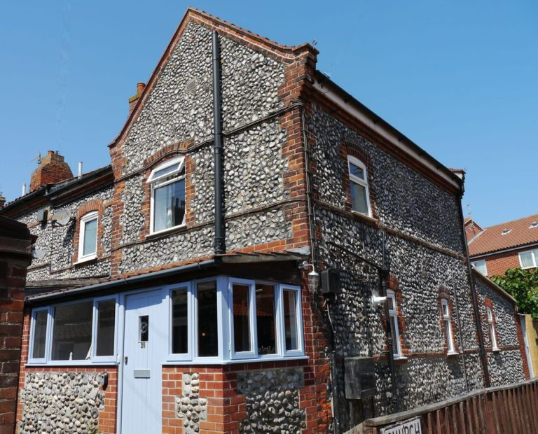 The xteriror of Cromer Flint Cottage