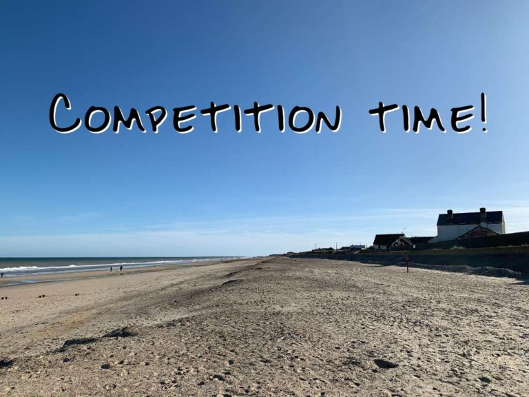 Beach scene with the words competition time